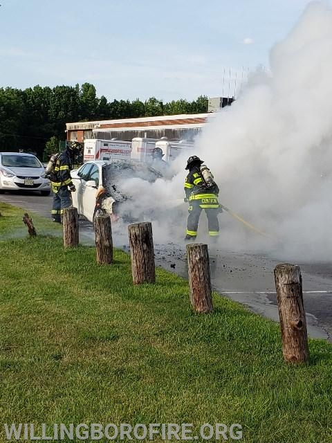 Working to completely extinguish the fire